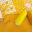 Accessories for sewing: threads, fabric, buttons in yellow-white — Stock Photo