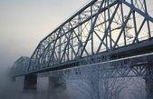 Railway bridge through the river — Stock Photo