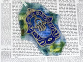 Hamsa kabala good luck charm on Talmud — Stock Photo