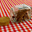 Stock Photo: Cinnamon sticks in glass jar