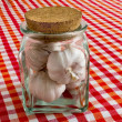 Stock Photo: Garlic bulbs in glass jar