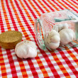 Stock Photo: Garlic bulbs in open glass jar