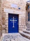 Old door with a Greek orthodox cross. — Stock Photo