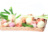 Different Types of Onions in a Basket — Stock Photo