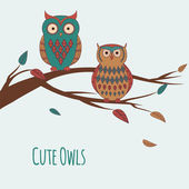 Vector illustration of two cute colorful owls sitting on a branc — Stock Vector