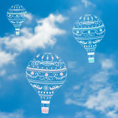 Vector illustration with decorative hot air ballons in blue sky — Stock Vector