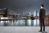 Man standing on pier — Stock Photo