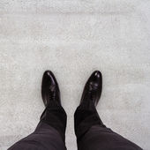 Businessman feet — Stock Photo