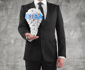 Man holding idea concept — Stock Photo