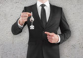 Businessman holding a key — Stock Photo
