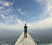 Businessman standing on pier — Stock Photo