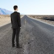 Businessman standing on road — Stock Photo #42913359