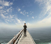 Businessman standing on pier — Stock Photo