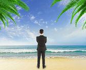 Businessman  on beach — Stock Photo