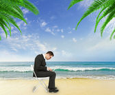 Businessman  on beach — Stockfoto