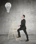 Businessman climbing — Stock Photo