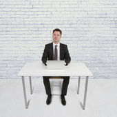 Man sitting in office — Stock Photo