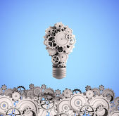 Bulb with gears — Stock Photo