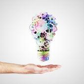 Hand holding light bulb — Stock Photo