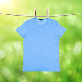 Washing blue tshirt — Stock Photo