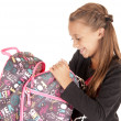 Young girl student opening her backpack — Stock Photo