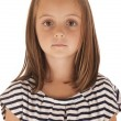 Cute young girl portrait looking right at camera in striped shir — Stock Photo