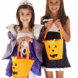 Two young sisters trick or treating a princess and a cheerleader — Stock Photo