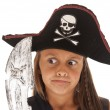Young pirate girl with pirates hat and sword, pulling funny face — Stock Photo