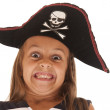 Young girl in pirate's hat pulling a very funny face — Stock Photo