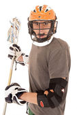 Intense male lacrosse player with helmet and stick — Foto de Stock