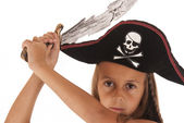 Cute young brunetter girl in a pirates costume with a hat and sw — Stock Photo