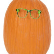 Funky pumpkin with green glasses fun and funny — Stock Photo