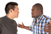 Ethnic brothers having an arguement with angry looks at each oth — Stock Photo