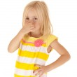 Young girl holding her nose keeping from a stinky smell funny — Stock Photo #33469077