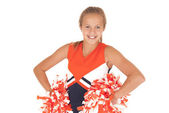 Young high school cheerleader with pom poms from waist up — Stock Photo