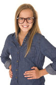 Teenage model in denim shirt and glasses smiling — Stock Photo
