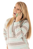 Young blonde woman talking on cell phone laughing — Stock Photo