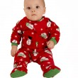Toddler boy sitting in red snowman pajamas — Stock Photo