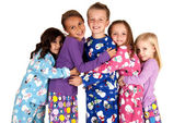 Children hugging in holiday christmas pajamas — Stock Photo