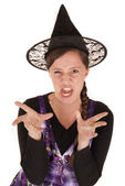 Young woman in black witch's hat funny expression — Stock Photo