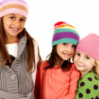 Three young girls wearing winter hats with cute expression — Stok fotoğraf