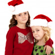 Young girl missing tooth smiling wearing santa hat — Stock Photo