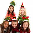 Five children in cute christmas hats smiling — Stock Photo #36314001