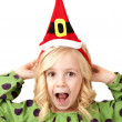Adorable fun blond girl wearing a santa hat — Stock Photo