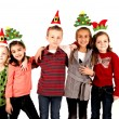 Five cute children in Christmas hats arm in arm — Stock Photo