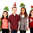 Cute kids in funny holiday hats — Stock Photo #36314017