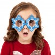Girl with funny expression in snowman glasses — Stock Photo