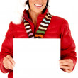 Female model wearing a santa hat and holding a blank sign — Stock Photo #37174407