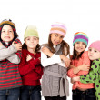 Children in winter hats shivering cold — Stock Photo