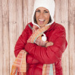 Fun expression female model sticking tongue out in winterwear — Stock Photo